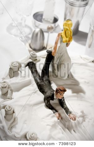 funny concept of wedding cake figurines