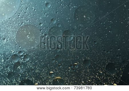 Oil drops grayish blue in the water -abstract background