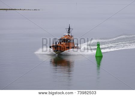 Red Pillot Vessel Over Skyline