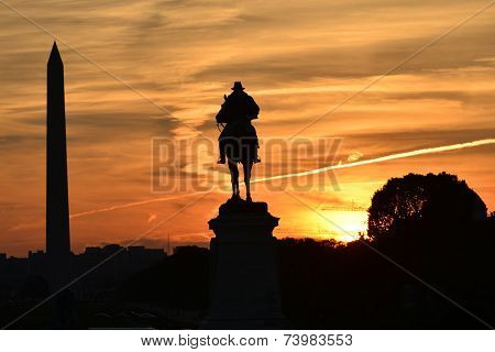Ulysses S. Grant Memorial and Washington Monument silhouettes in sunset - Washington DC, United States of America