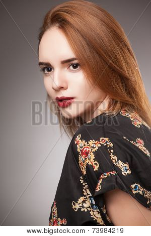 portrait of an young girl with brown hair, studio shot