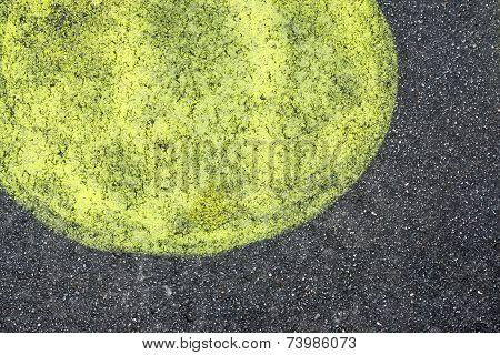 Spot Of Lemon Color On Black Asphalt
