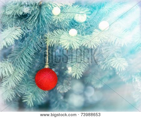 Red bauble on Christmas tree (xmas ball)