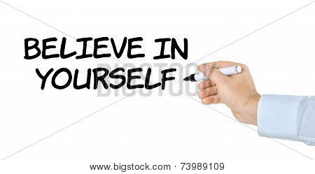 Hand with pen writing Believe in yourself