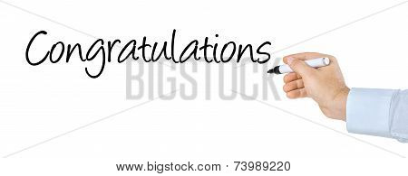 Hand with pen writing the word Congratulations