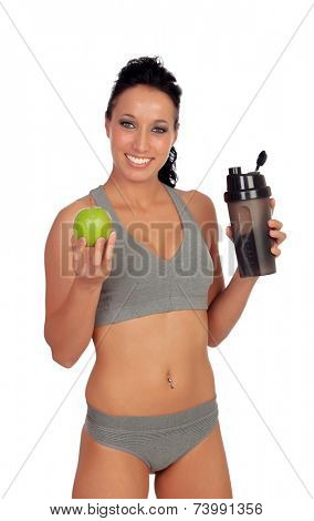 Woman after her training, drinking protein shake and with an apple in hand
