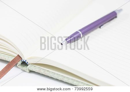 Closeup Opened Notebook With Pen On White Background