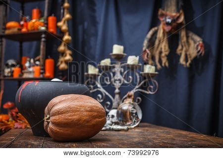 Table With A Pot, Pumpkin, Crystal Ball Chandelier And To Celebrate Halloween