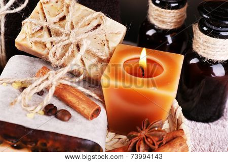 Organic soap with coffee beans, sea salt on wicker mat, on  table background, Coffee spa concept