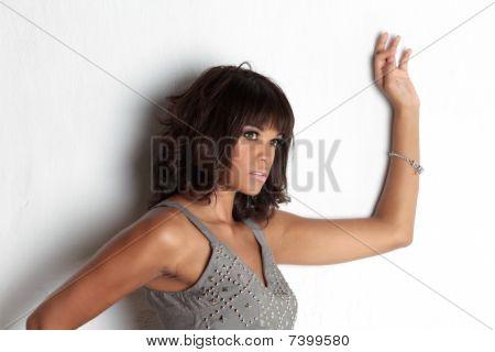Elegant Brunette Against Wall
