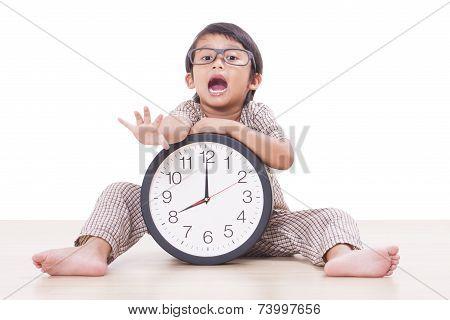 ute boy is holding big clock