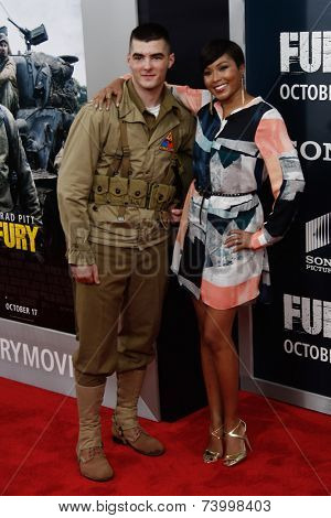 WASHINGTON, DC-OCT 15: TV host Alicia Quarles poses with a soldier at the world premiere of