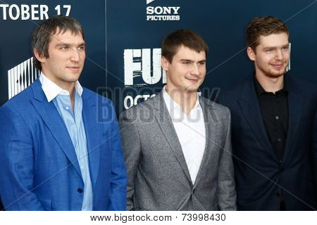 WASHINGTON, DC-OCT 15: NHL players Alex Ovechkin (L), Dmitry Orlov (C) and Evgeny Kuznetsov of the Washington Capitals at