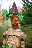 picture of scarecrow  - Creative straw scarecrow in a countryside garden - JPG