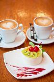 stock photo of cherry pie  - tasty fruit dessert with cherry and kiwi with coffee - JPG