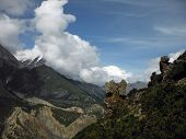 image of nepali  - An odd rock formation on a mountain in the Nepali Annapurna Himalayas during monsoon with the cloud - JPG