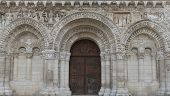 stock photo of poitiers  - Wooden door of the church of Poitiers in France - JPG