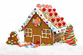 picture of gingerbread house  - Colorful gingerbread house in snow isolated on white - JPG