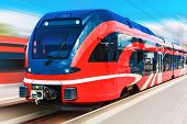 image of high-speed train  - Scenic summer view of modern high speed passenger commuter train on tracks at the station platform with motion blur effect - JPG