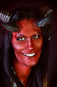 stock photo of hade  - Portrait of a smiling devil with horns - JPG
