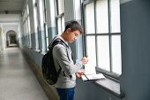 Man with backpack and schoolbooks at college poster