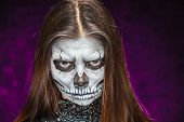stock photo of day dead skull  - Young woman in day of the dead mask skull face art - JPG