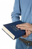 foto of bible verses  - Man holding Bible isolated on white - JPG