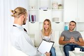 picture of not talking  - Unhappy couple not talking on couch at therapy session - JPG