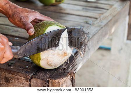 Man Chopping Coconut By Big Knife