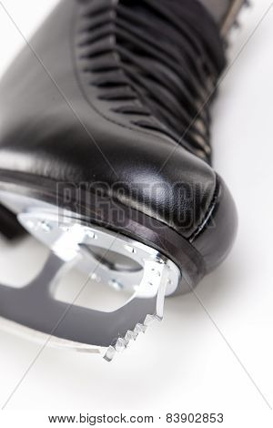 Closeup Shot Of Sharp Cog Of Professional Male Figure Skate. Over White Background.