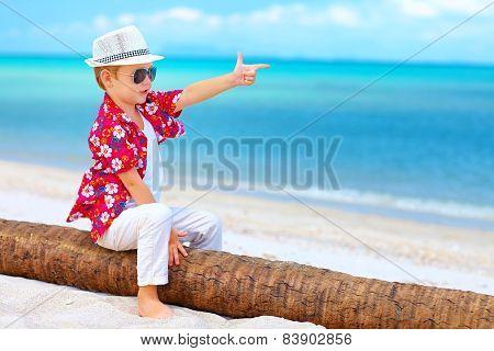 Cute Boy Playing A Gangster On Summer Beach