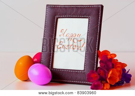 Easter Eggs And Freesia In Basket On White Background