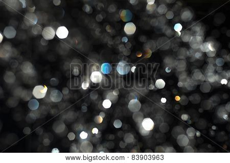Abstract  bokeh. Blurred water drops backlit. Levitation of rain drops defocused
