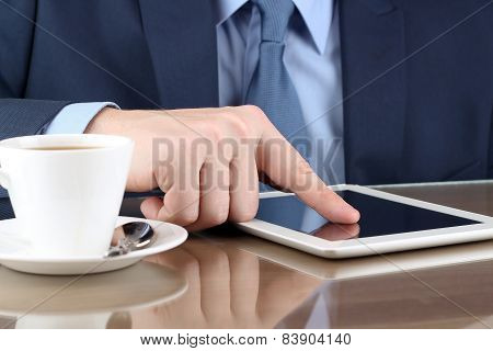 Businesman  Working With A Digital Table In The Office