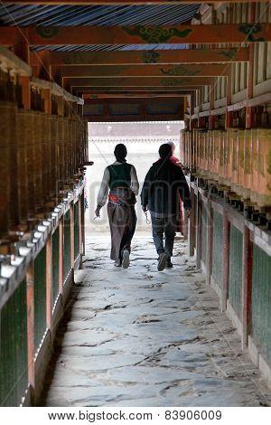 Tibetan People And Prayer Wheels, Labrang Monastery