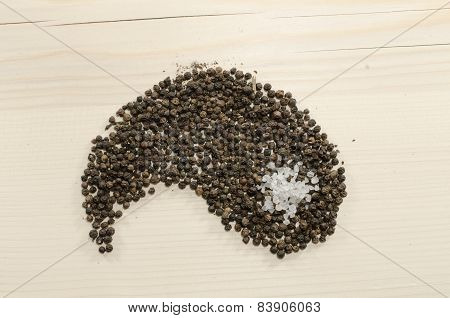 Pepper as yang on wooden background, Yin and Yang concept