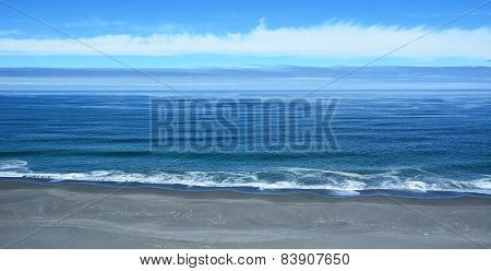 Pacific Ocean From The Top With Blue Sky Background