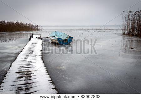 Old Boat In A Frozen Lake Winter