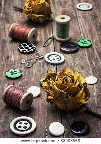 sewing buttons and thread