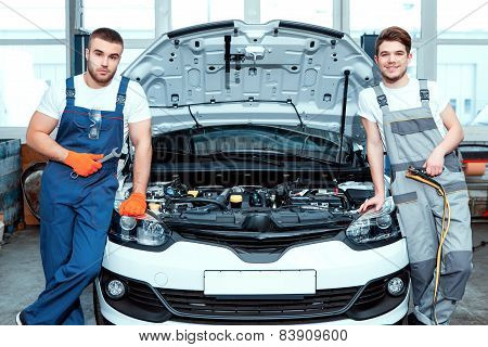 Car mechanics at the service station