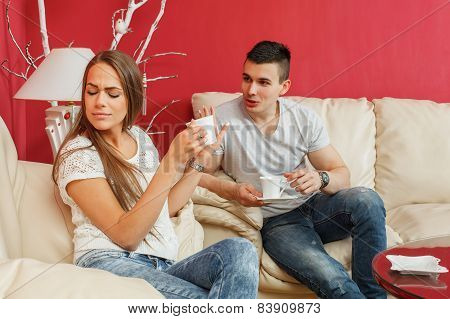 Young Couple Drinking Coffee And Chatting