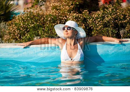 Attractive Woman In The Pool
