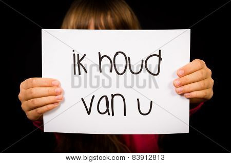 Child Holding Sign With Dutch Words Ik Houd Van U - I Love You