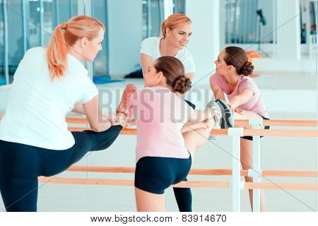 Mother and teenage girl at dancing club