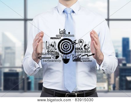 Businessman Holding Success Plan
