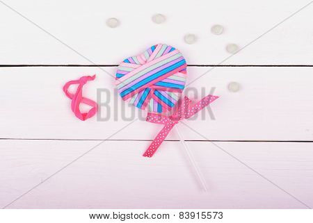Sign infinity on white background with candy for Women day
