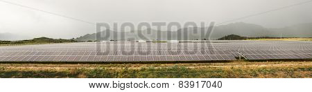 Solar Panel Power Station On Cloudy Day