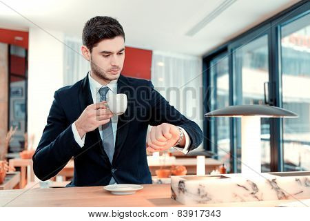 Beautiful young man having a lunch