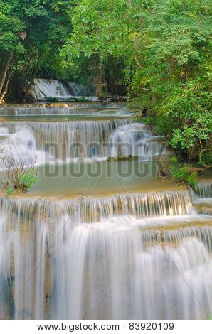 Waterfall In Deep Rain Forest Jungle.
