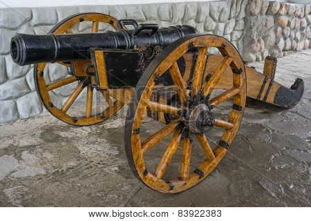 Old Medieval Artillery Canon Before A Stone Wall